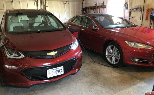 Charging 2017 Chevrolet Bolt EV and 2015 Tesla Model S P85D at home in garage [photo: Jay Lucas]